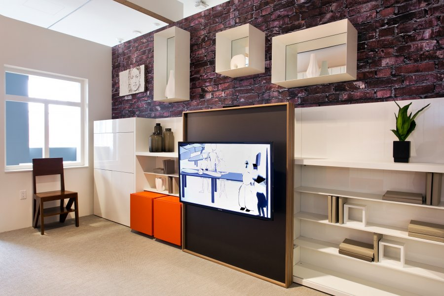 Decorate-a-small-house-a-closer-look-at-the-shelves-and-tv-the-white-storage  NYC's Interior Design Plan For Small Apartments a closer look at the shelves and tv the white storage